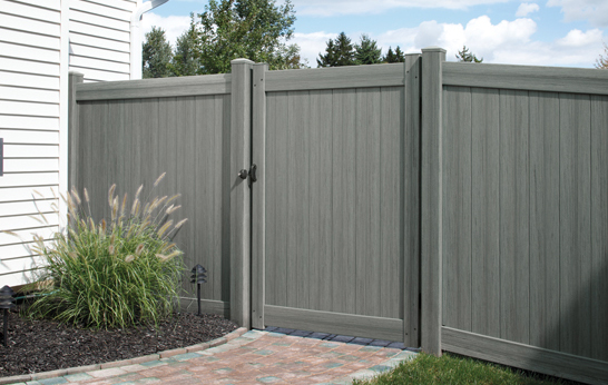 Arctic Blend Vinyl Privacy Fence and Gate with Brick Walkway